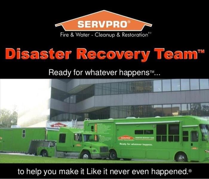 SERVPRO's Disaster Recovery big rigs in front of a commercial building
